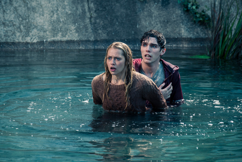 "R (right), an unusual zombie, saves Julie from an attack and the two form an unlikely relationship in ""Warm Bodies,"" directed by Jonathan Levine."