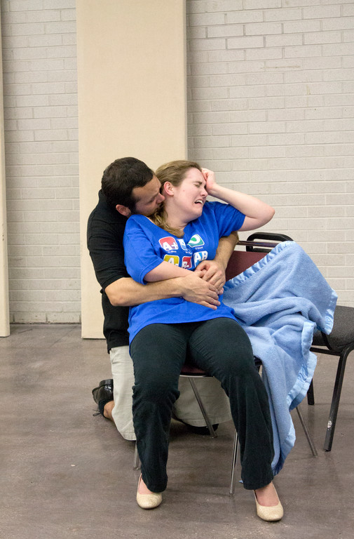 "Mozart (Erik DeCicco) comforts his wife, Constanze (Kelby Siddons), during rehearsals of ""Amadeus"" in February."