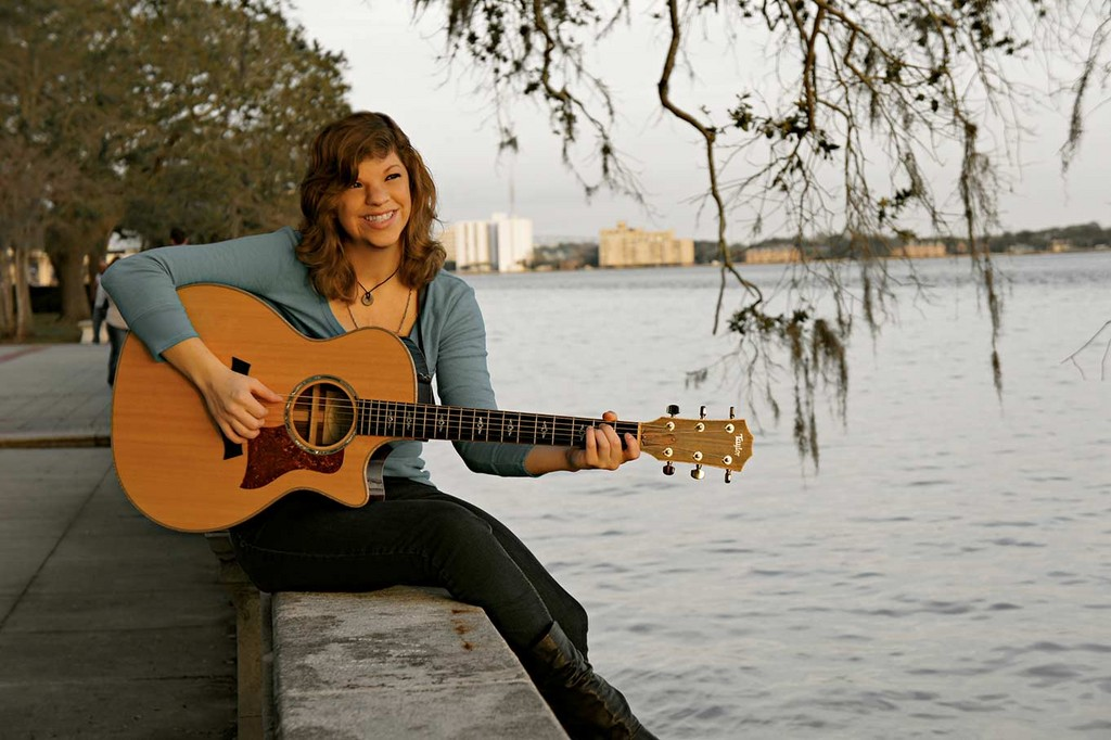 Guitarist Jenni Reid said she�s following advice she heard from one of her favorite musicians, John Mayer. She's set small goals for herself to achieve success; her next one is to play more shows out of town. She has plans to play in Orlando on March 22.
