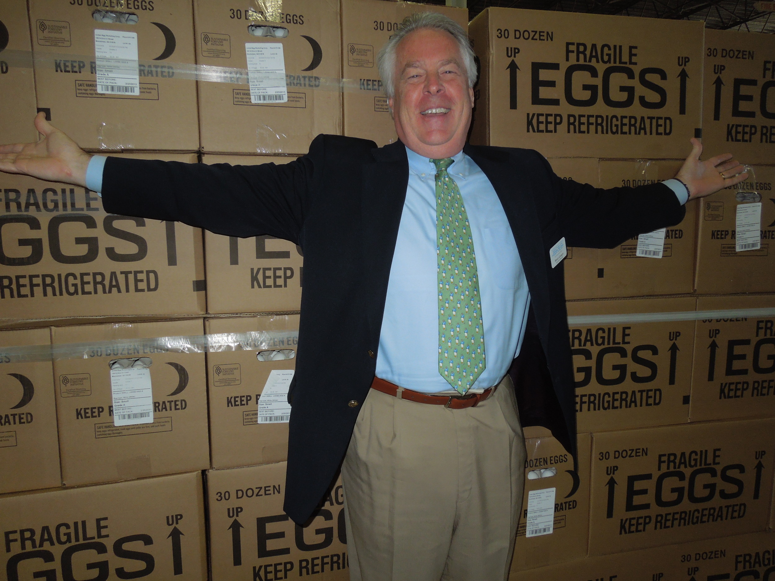 Bruce Ganger, executive director of Second Harvest of North Florida, stands in front of 86,400 eggs donated to the food bank by Dixie Egg of Jacksonvlle.