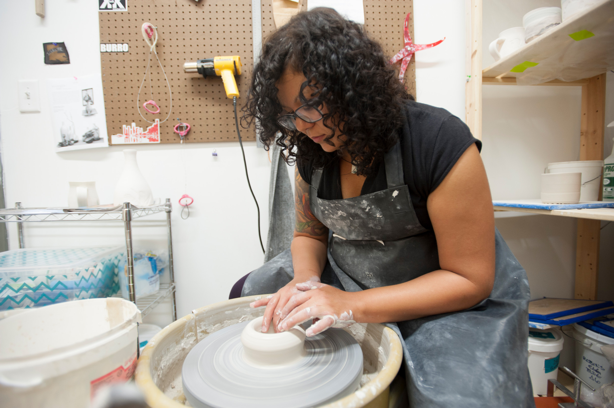 Koula Redmond prepares a ceramic art piece for Free Art Friday.