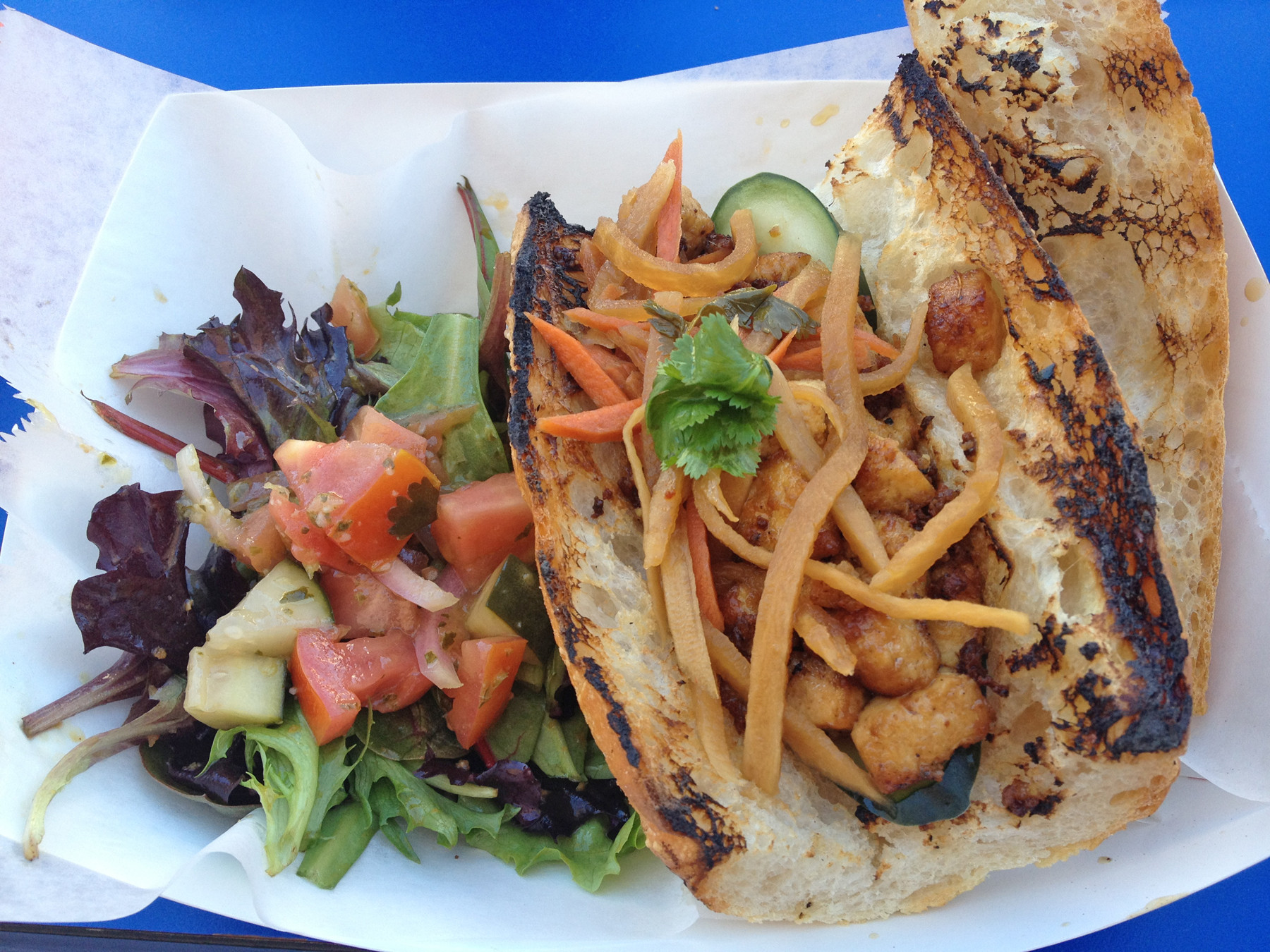 Try the tofu and pickled veggie bahn mi with a side of salad at Chomp Chomp.