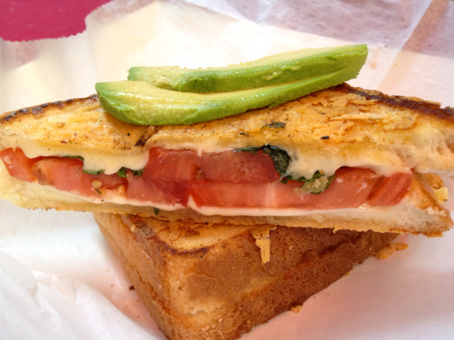 On The Fly offers a parmesan-crusted grilled cheese with brie, tomato and pesto topped with avocado.