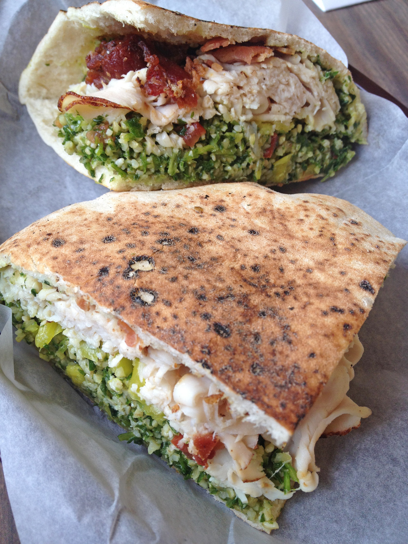 The Late Bloomer at Whiteway Delicatessen is a pressed pita stuffed with shaved turkey, provolone, tabouli, avocado spread, banana peppers and crispy bacon.
