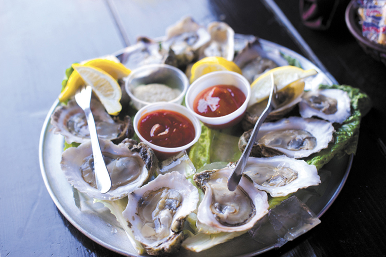 Thursdays at Sliders Seafood Grille are packed with folks hungry for unbeatable specials, like half-priced raw oysters by the dozen.