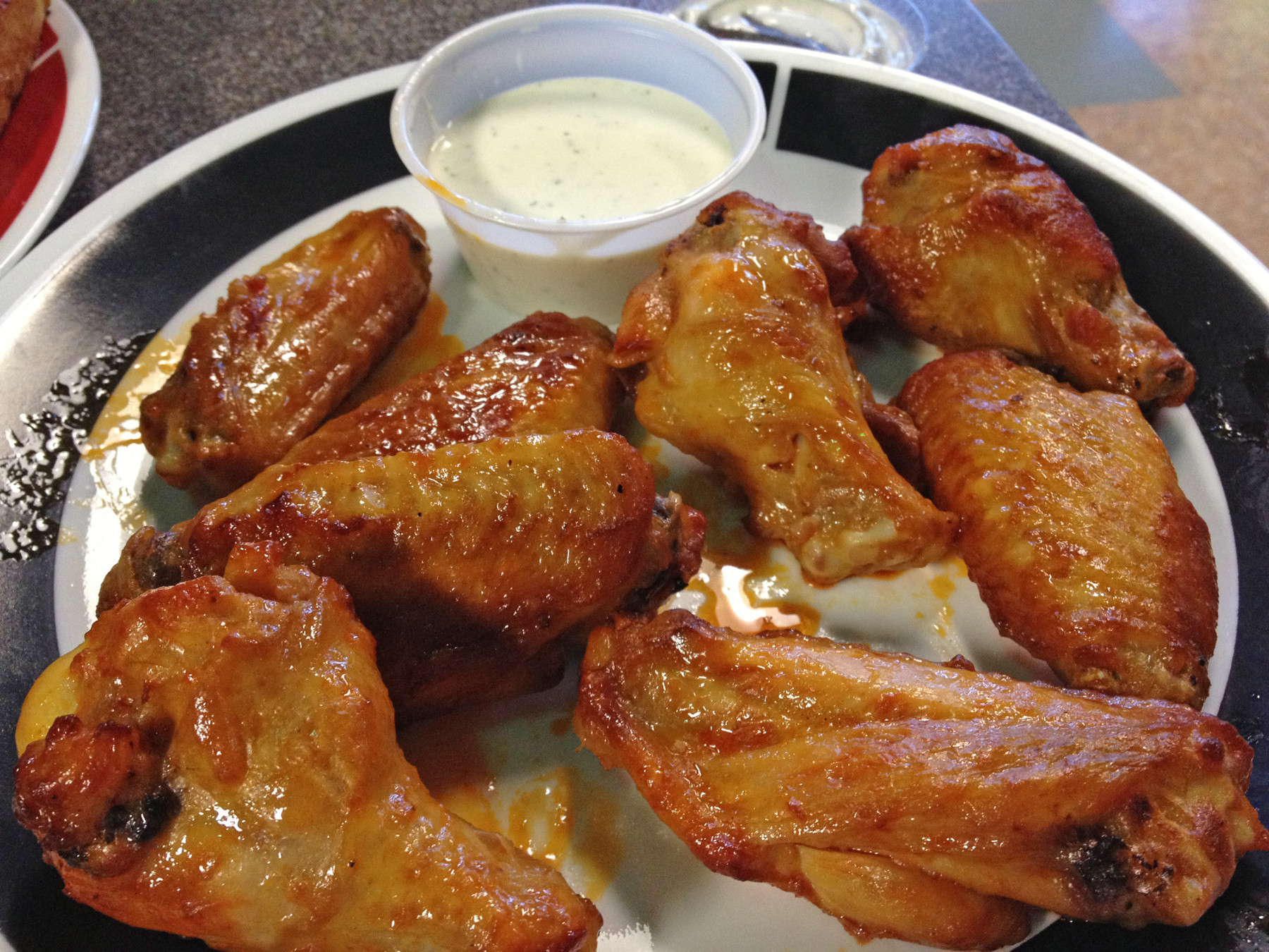 Guido Spoonpipe's wings — available in plain, BBQ, sweet BBQ, mild and hot — are lightly breaded and baked, not fried.