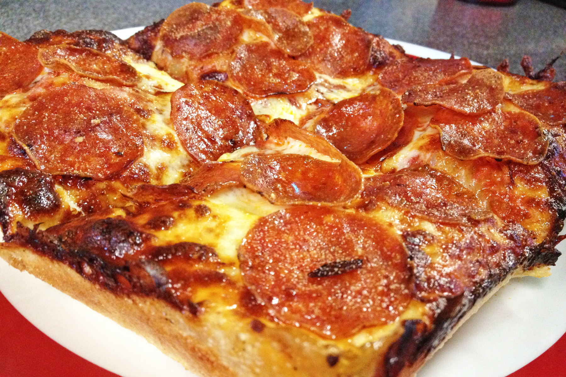 The pepperoni Florida Smacker has cheese that goes all the way to the ends of the deep-dish crust.