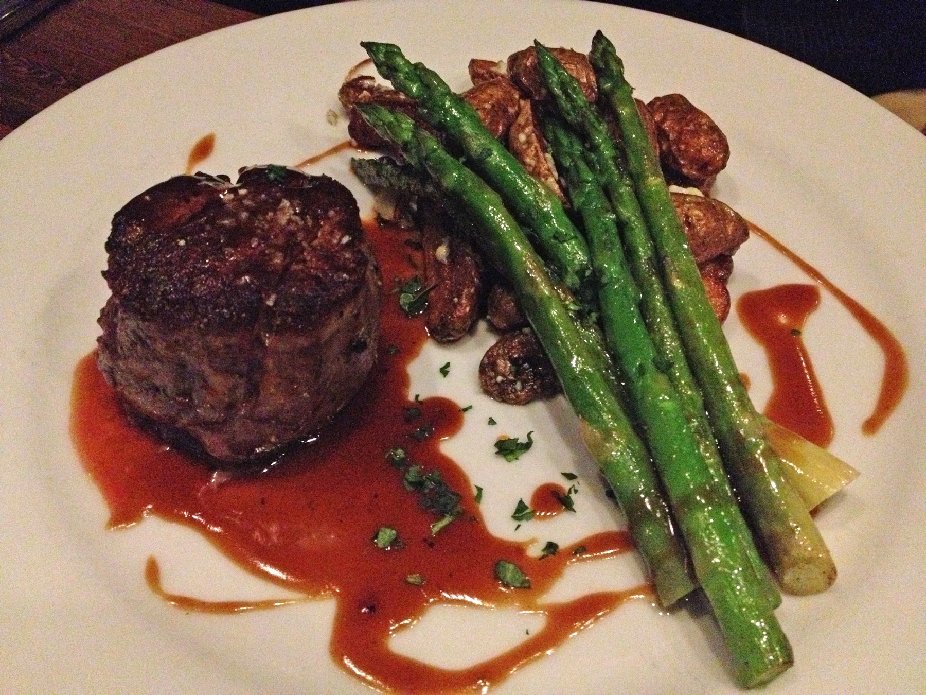 The beef filet is topped with a rich, flavorful bordelaise demi-glaçe, served with bleu cheese fingerling potatoes and fresh asparagus spears.