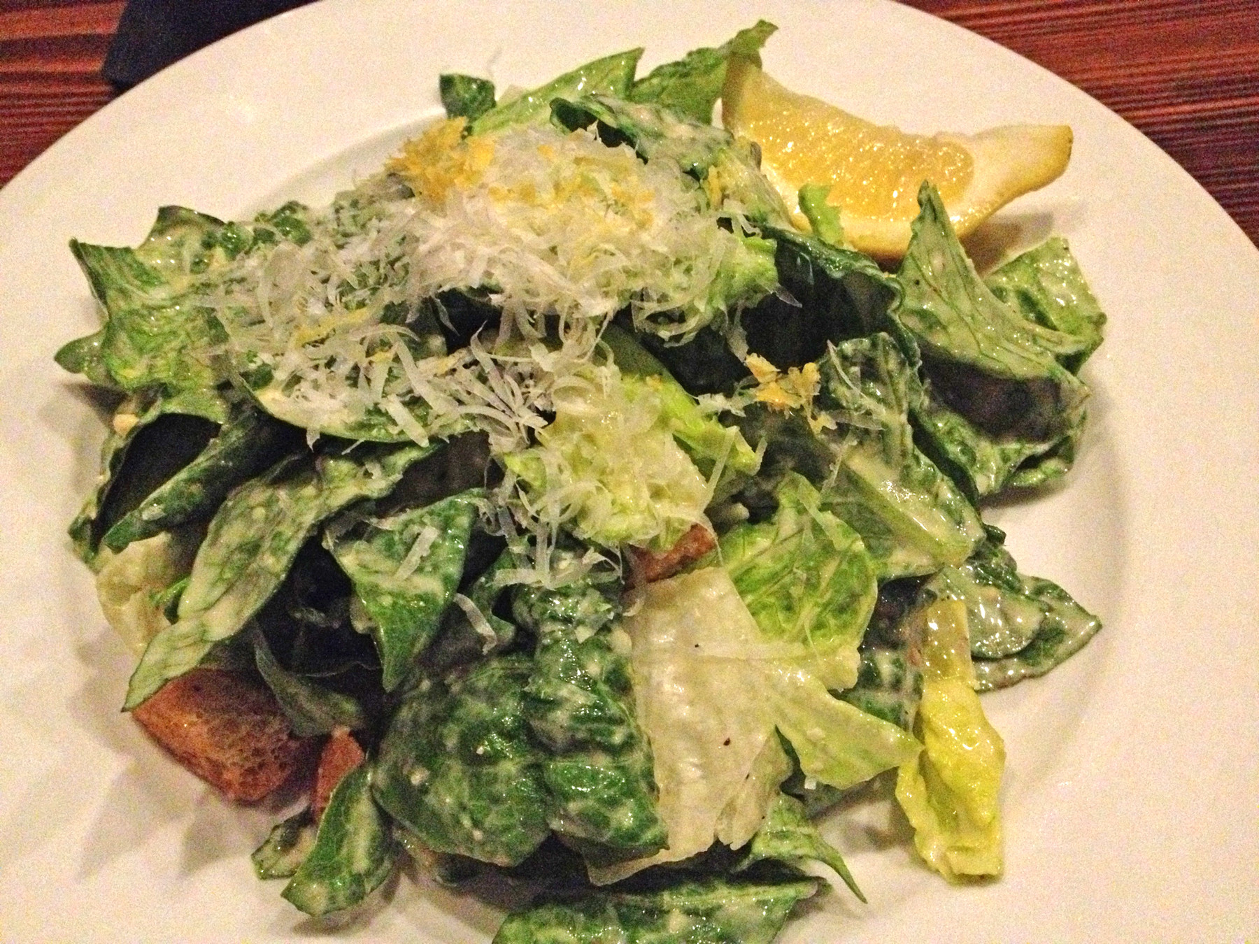 The Caesar salad is traditional with crisp Romaine, crunchy croutons, fresh parmesan and just the right amount of homemade dressing.