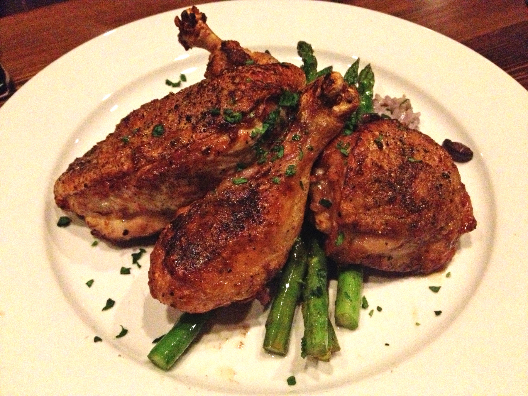 The Black Hog Farm roasted free-range half-chicken comes with red wine risotto, mushroom marmalade and asparagus.