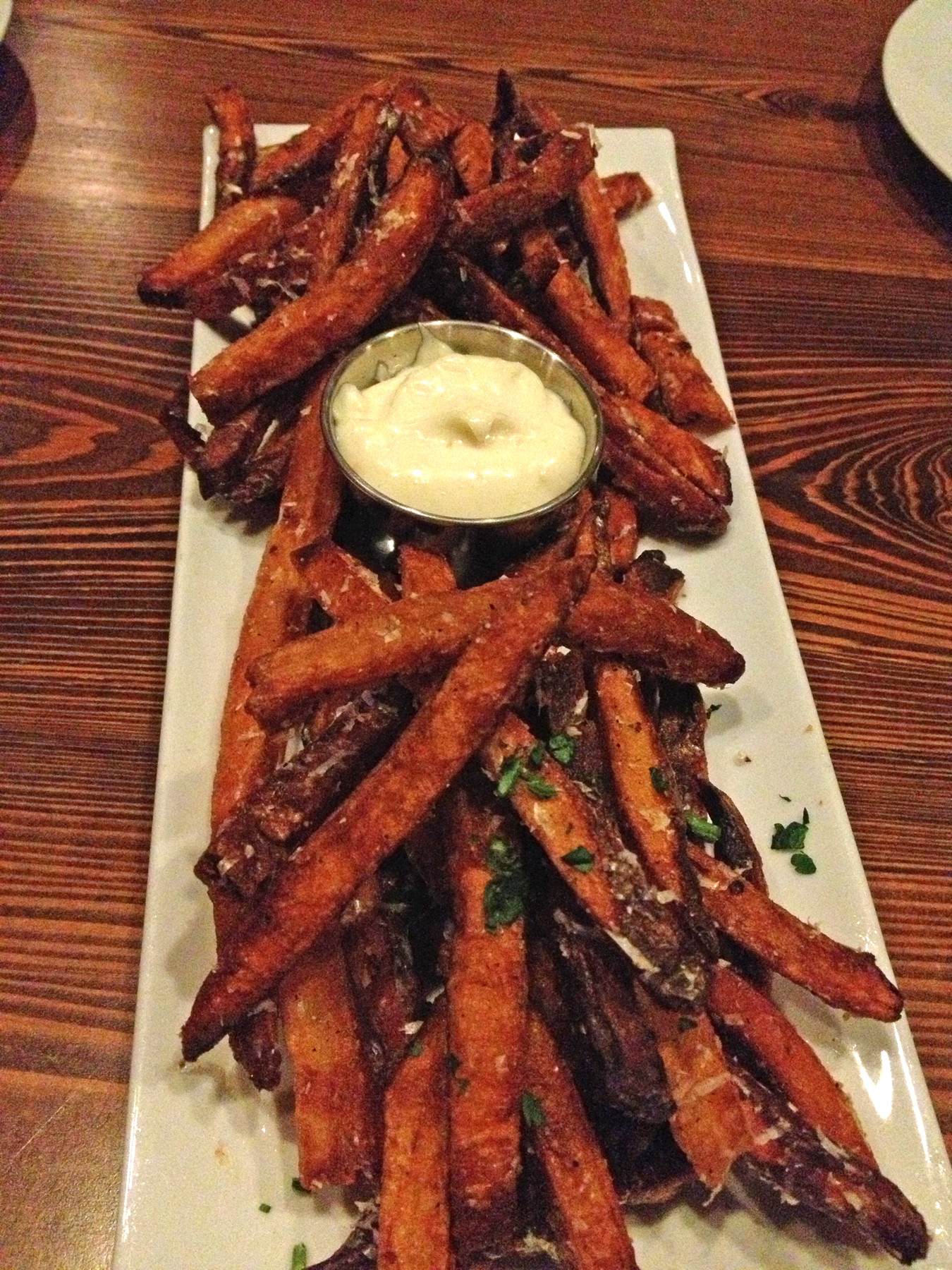 The French fries, with freshly grated parmesan, truffle oil and creamy garlicky aioli, are delightfully crisp.