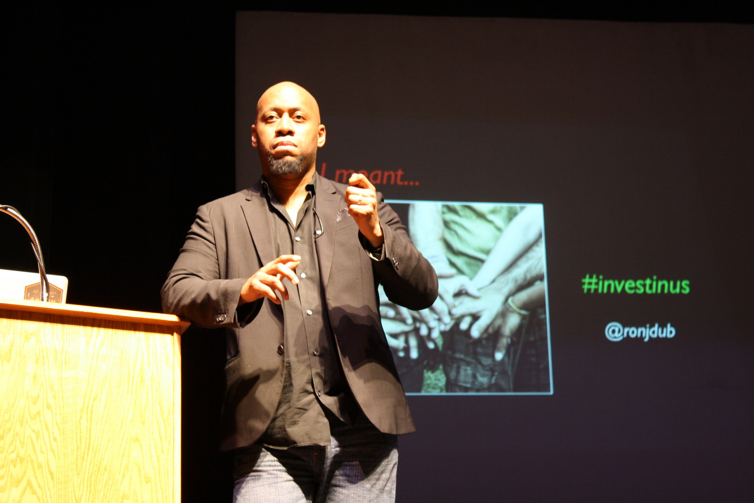 Ron J. Williams addresses One Spark crowd at the Terry Theater.