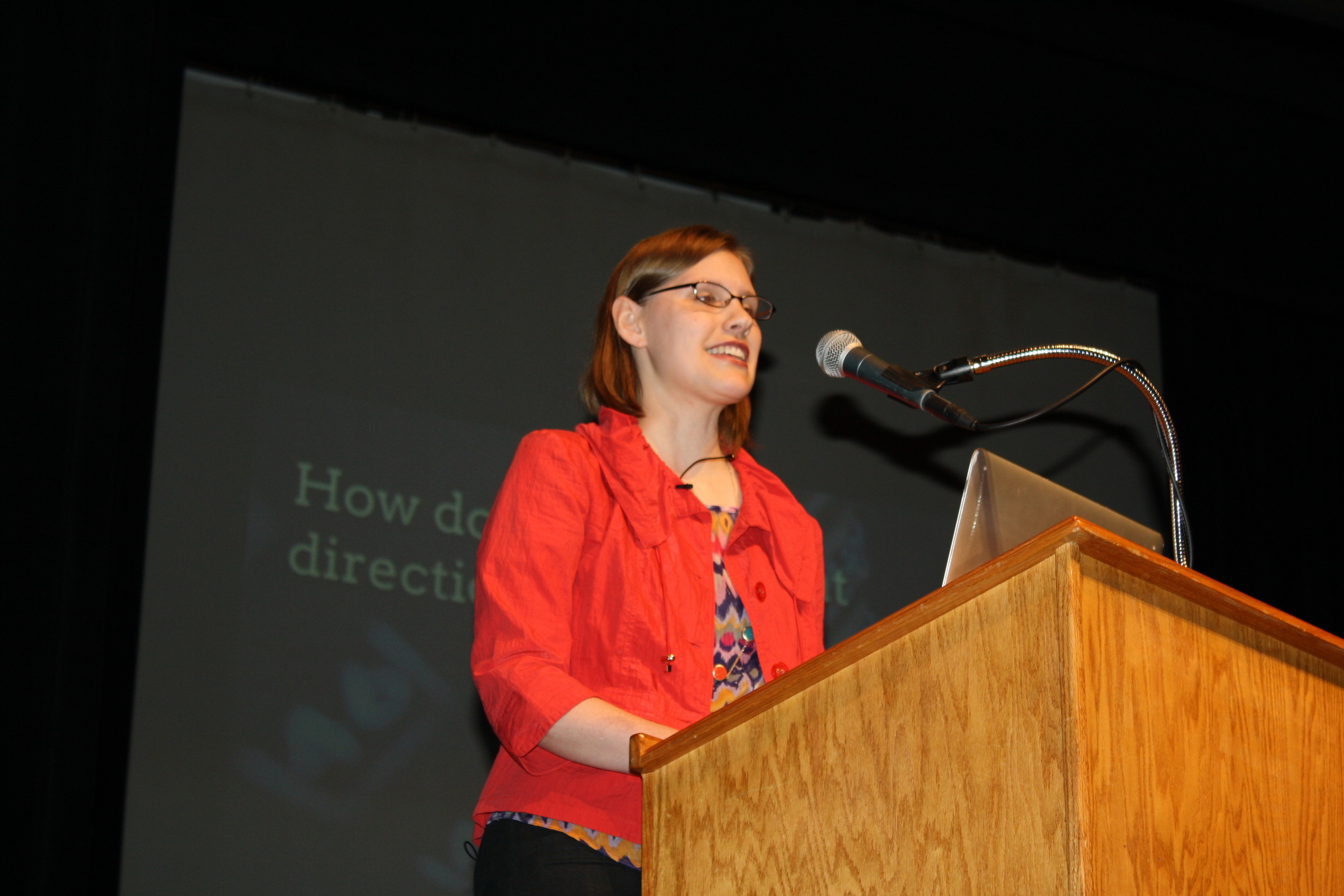 Dr. Leslie Jensen-Inman addresses the crowd during One Spark Speaker Series at the Terry Theater.