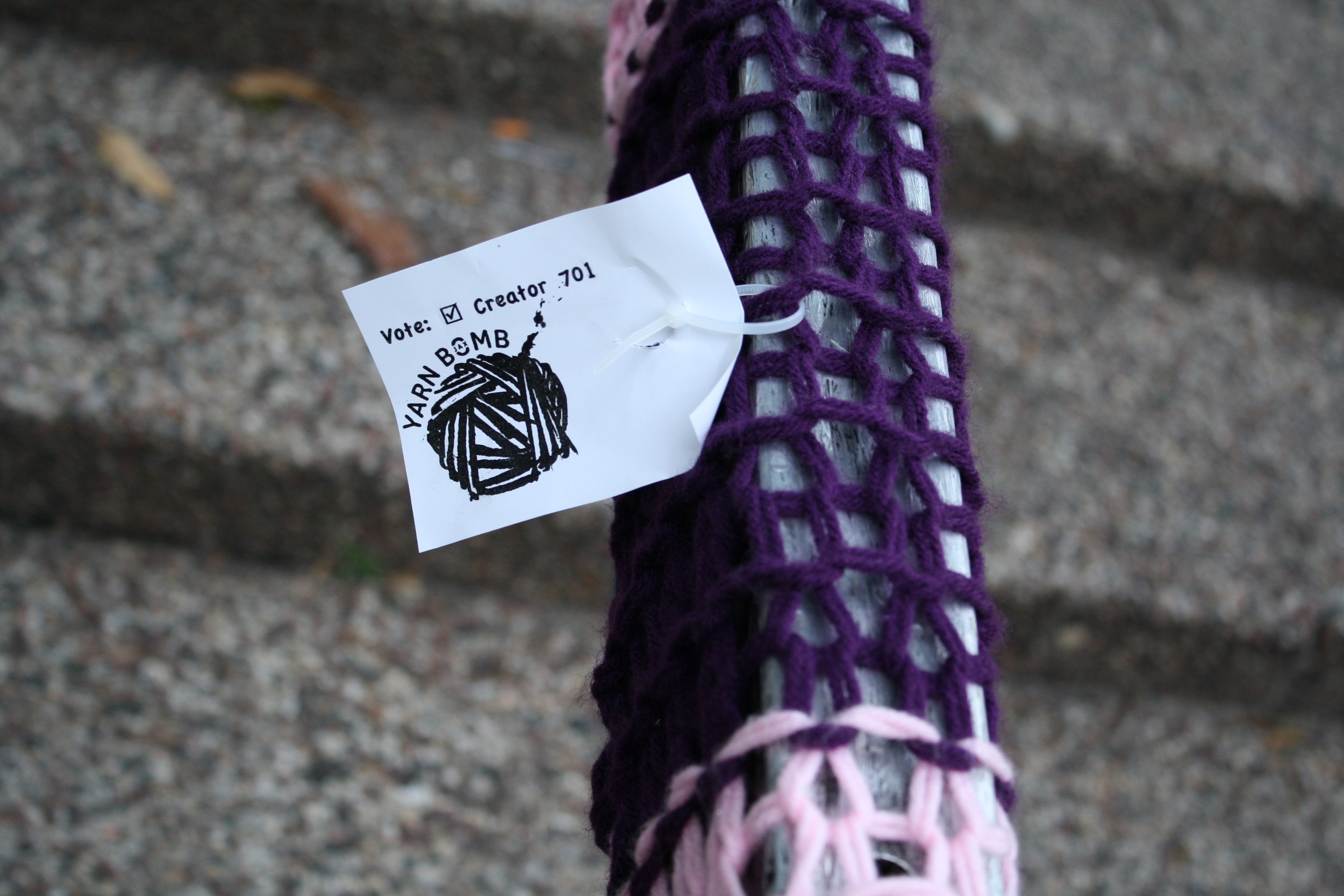 One of Jackie Kuhn's yarn bombings in Hemming Plaza.