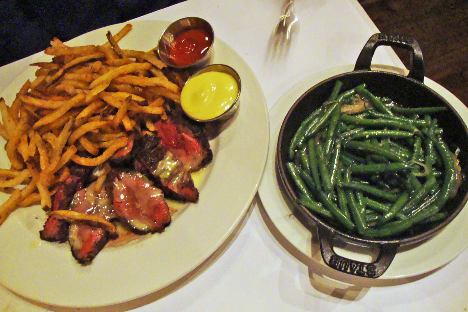 The steak frites — a perfectly cooked hangar steak with a salty, seared crust, served with a tower of thinly cut, crisp frites fried in duck fat for extra flavor — are an Orsay dinner staple.