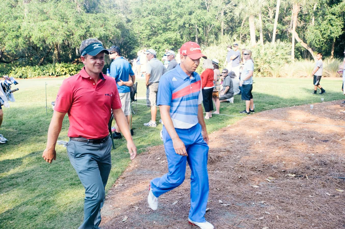 Luke Donald and Sergio Garcia walk to the 12th hole together.