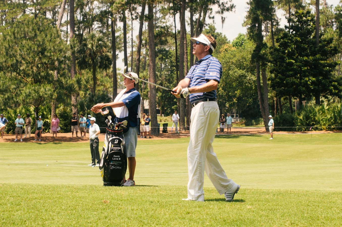 Davis Love III takes a shot on the 11th fairway.