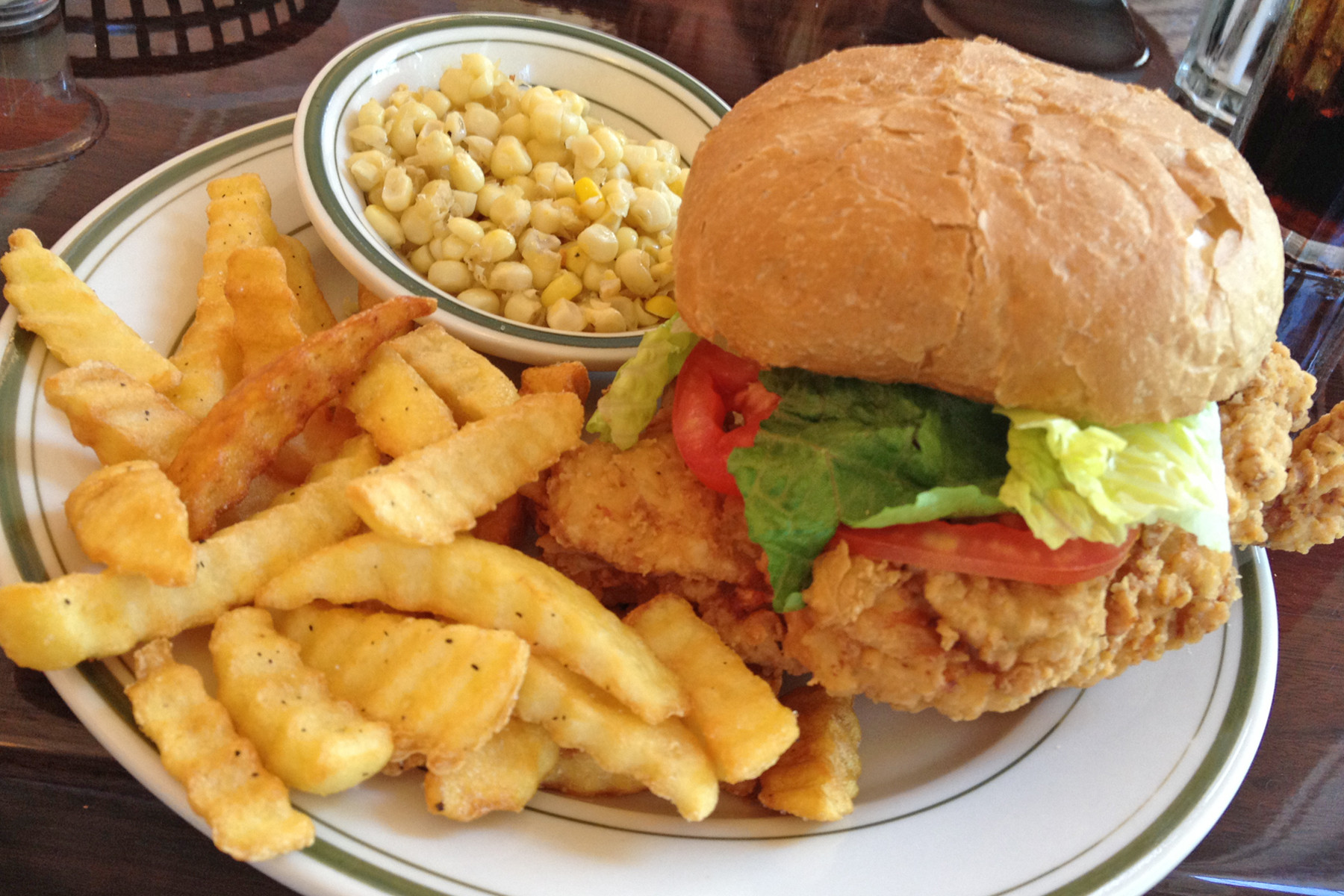 The juicy, tender fried chicken on a Kaiser roll with lettuce, tomato and mayonnaise can be ordered with knife-cut corn and crinkle-cut fries.