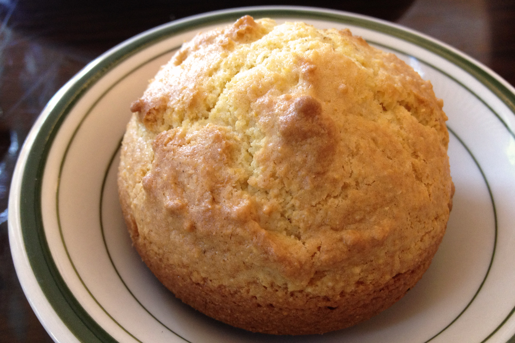 The muffin-shaped cornbread is sweet and moist, with a nice crisp crust.