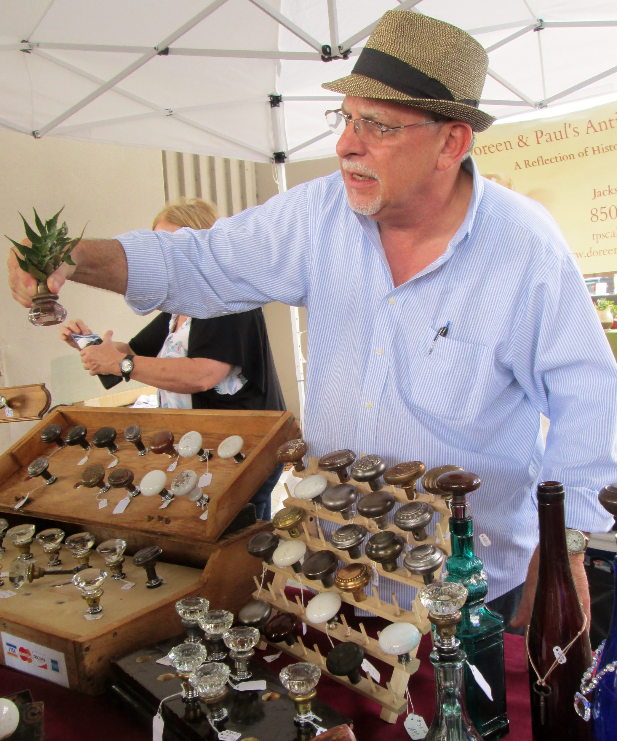 Ted Scallan sells antique door handle wine bottle openers and corks.
