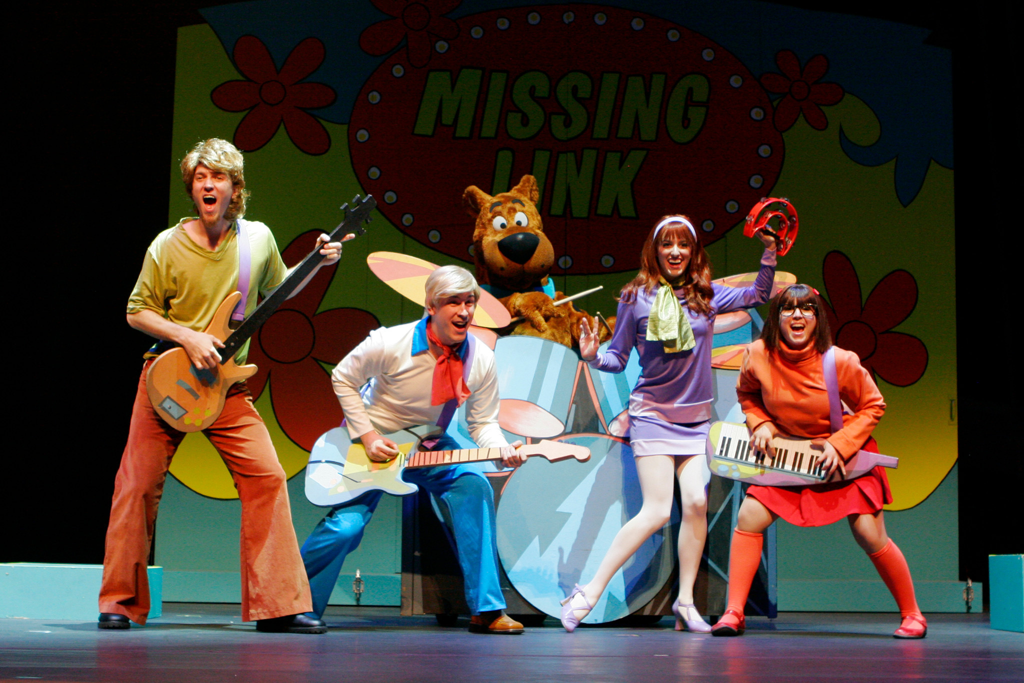 "Scooby-Doo and the Mystery Inc. Gang perform as Missing Link in order to catch a ghost in ""Scooby-Doo Live! Musical Mysteries,"" presented by Warner Bros. Consumer Products and Life Like Touring."
