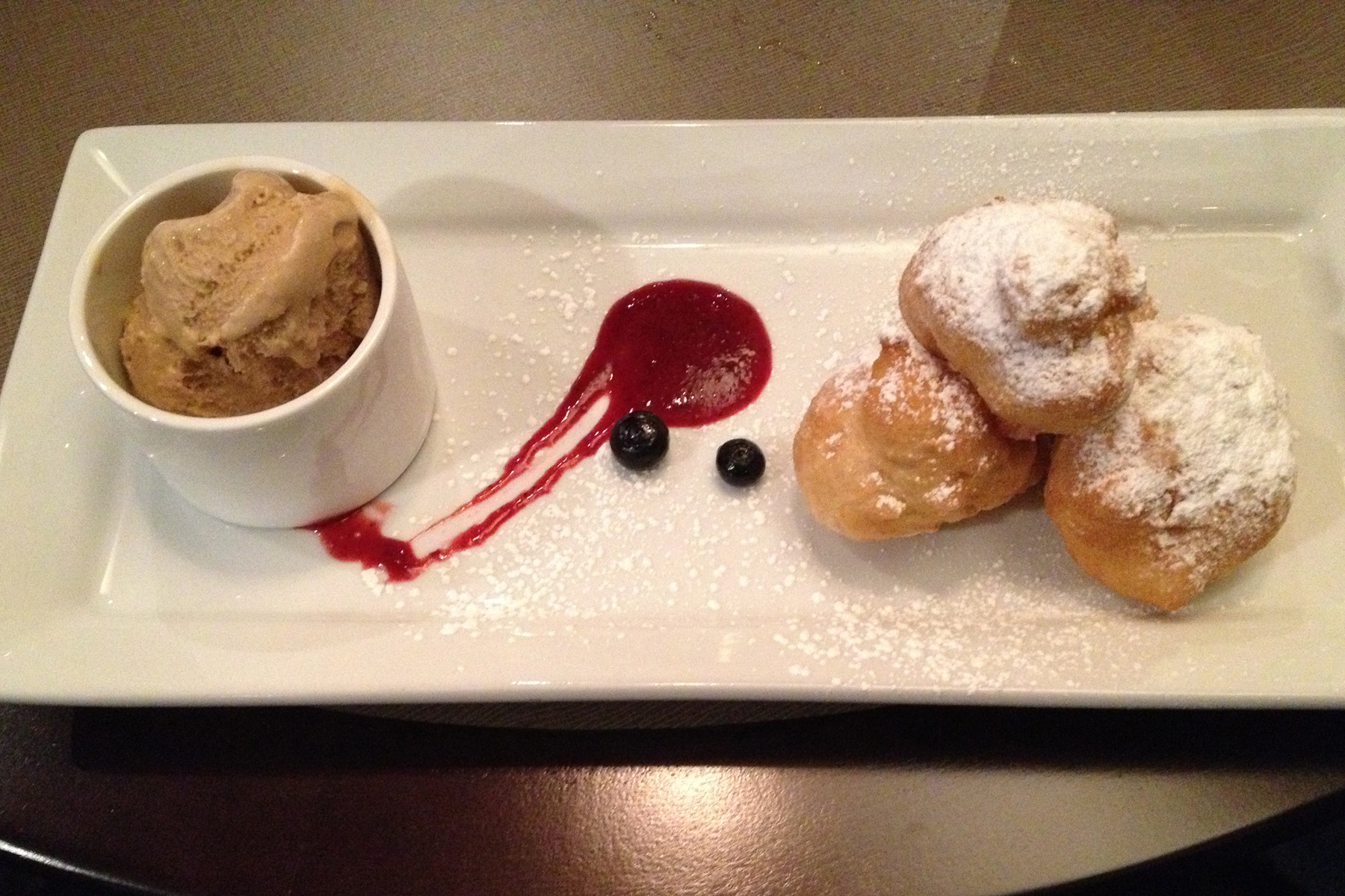 "The can't-miss-it dessert, espresso ""coffee and doughnuts,"" is a fun take on New Orleans beignets."