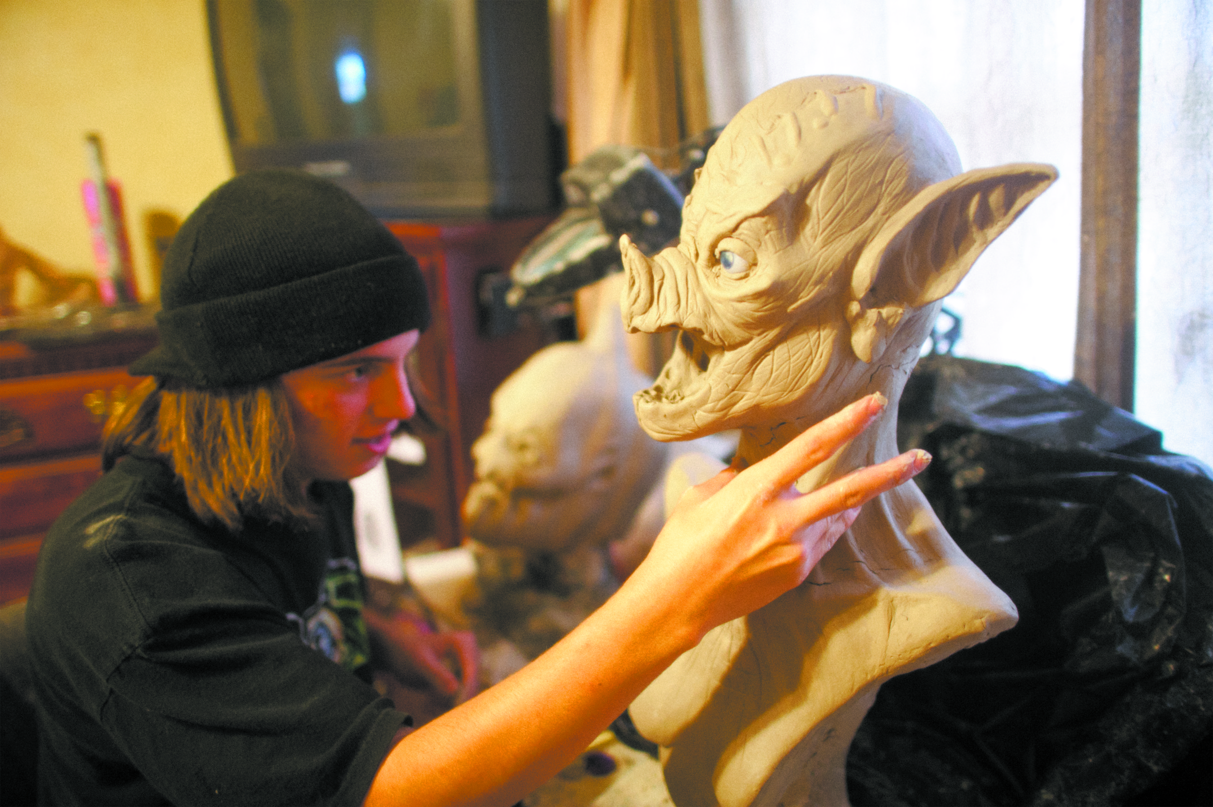 Tyler Pasquale works with latex, plaster and airbrushing out of his room in Arlington.