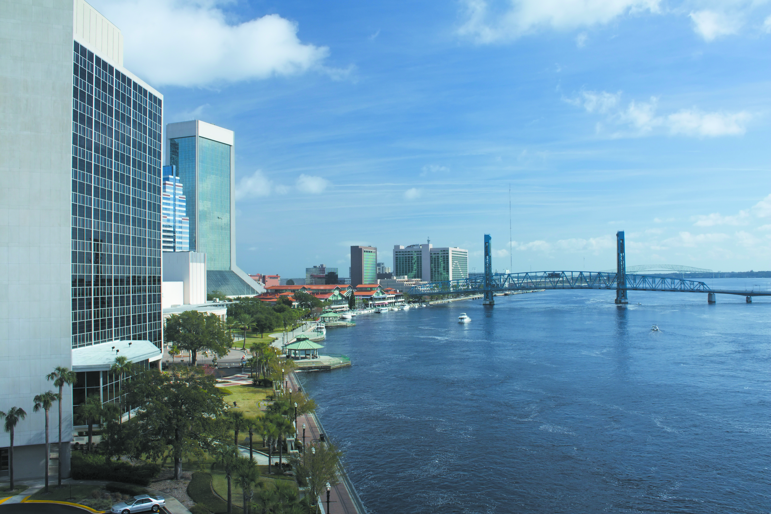 The northward-flowing St. Johns River meanders through Downtown Jacksonville before heading past the ports, eventually spilling into the Atlantic Ocean.