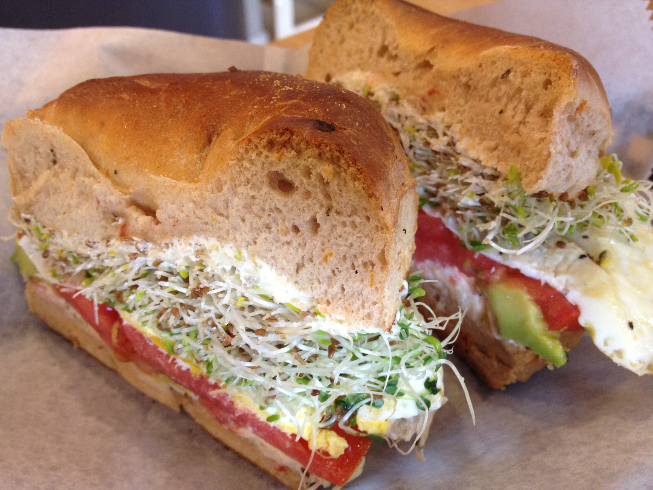 The Cali Love is a filling breakfast sandwich: egg, tomato, sprouts, avocado and your choice of cream cheese on a toasted bagel.