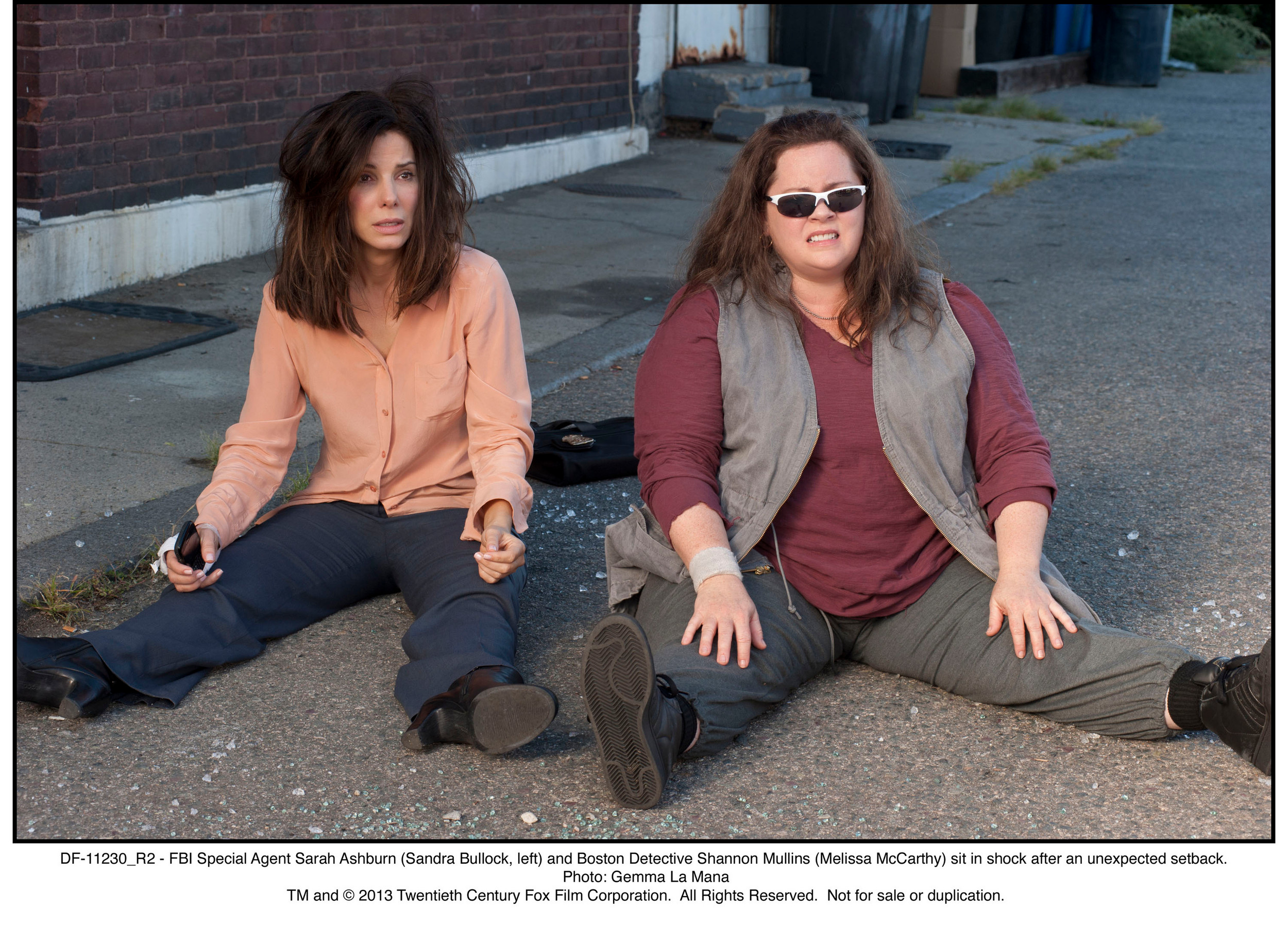 "FBI Special Agent Sarah Ashburn (Sandra Bullock, left) and Boston detective Shannon Mullins (Melissa McCarthy) experience an unexpected setback in ""The Heat,"" directed by Paul Feig."