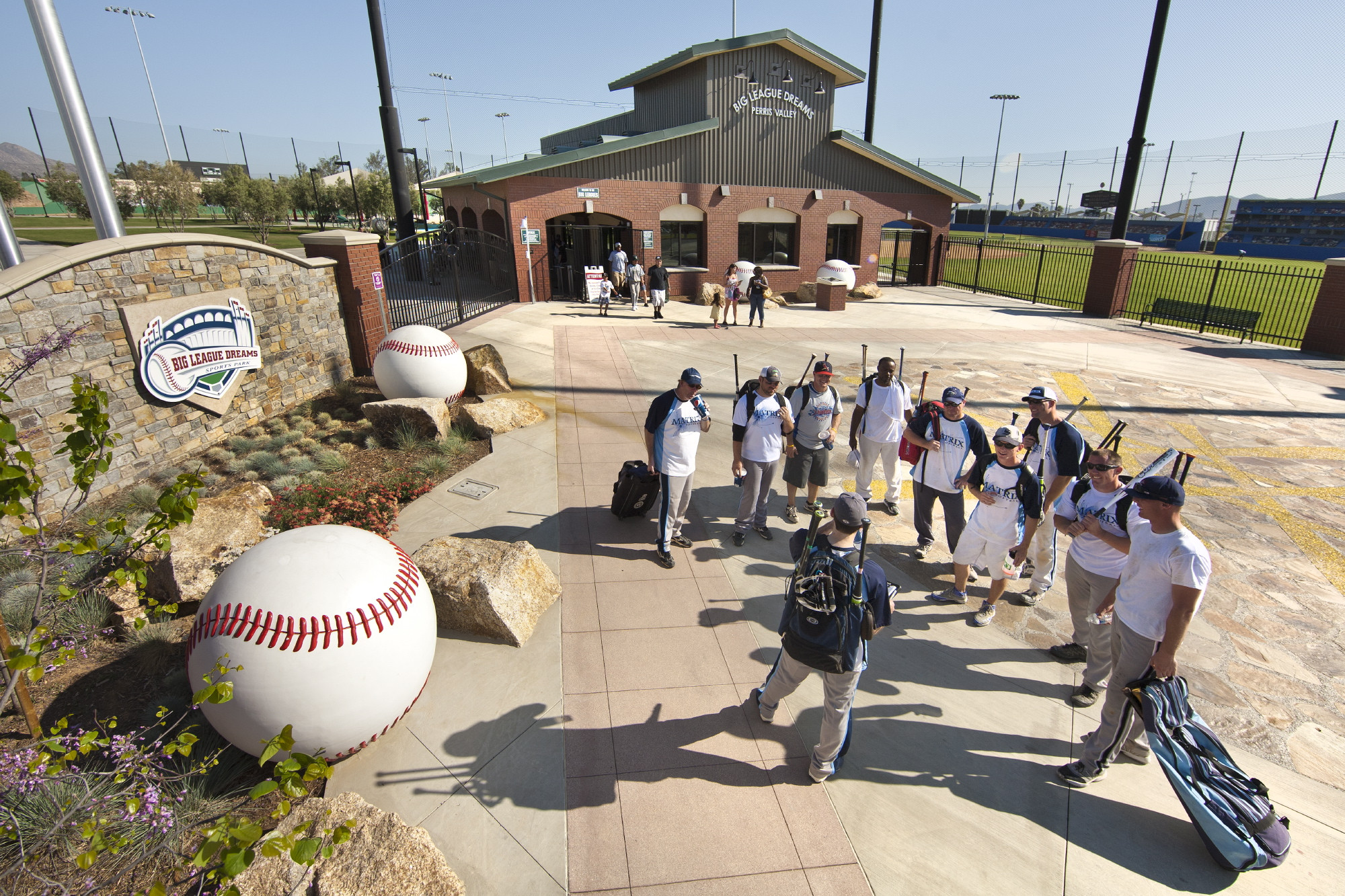 A team gathers outside a Big League Dreams facility near Perris, Calif. The California facility is similar to a $19 million facility planned for Clay County.