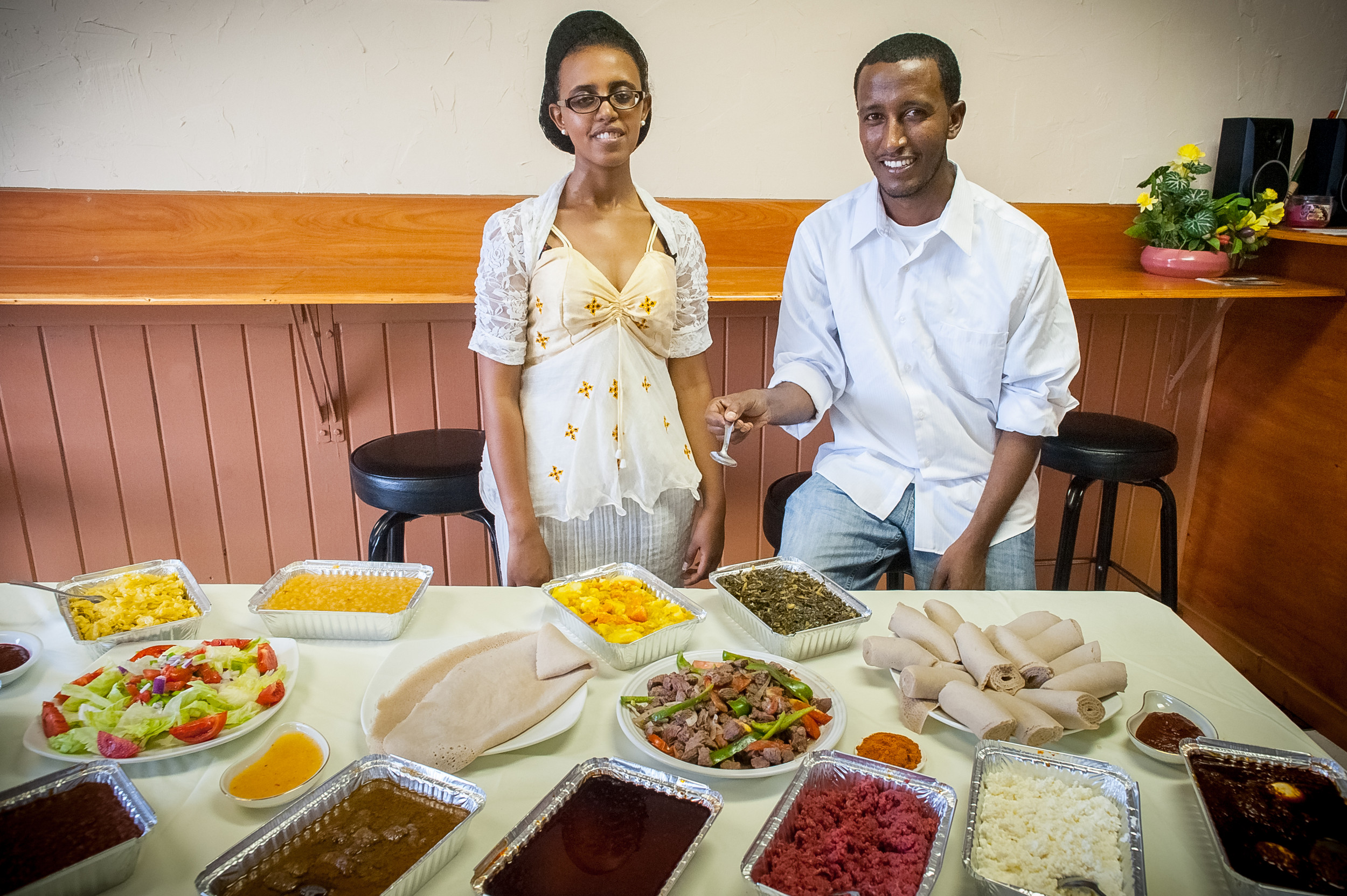 At Nile Ethiopian, family-style platters are served with an oversized spongy, thin, crepe-like flatbread called injera, used to pinch up a scoop of food.
