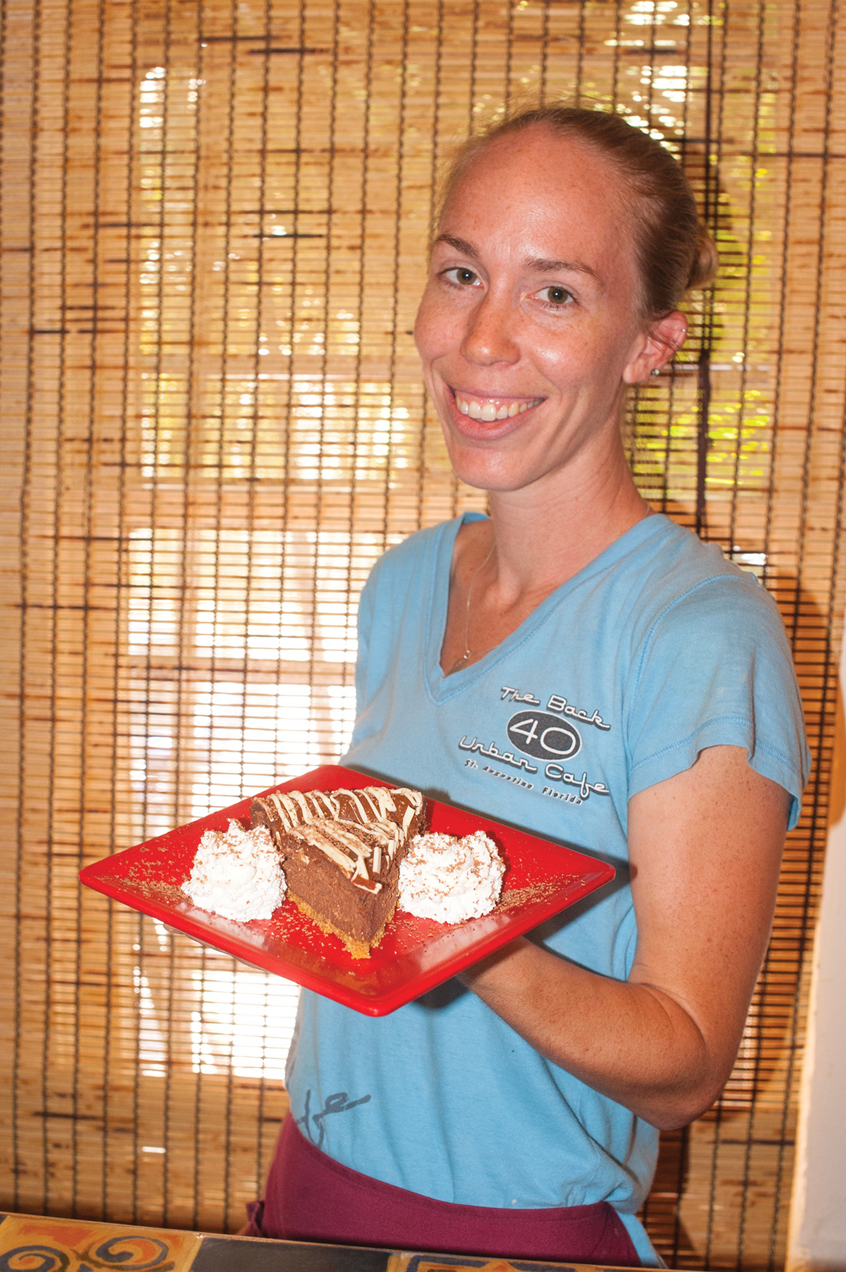 Ariel Edwards of The Back 40 Urban Café in St. Augustine presents the triple chocolate Kahlúa cheesecake.