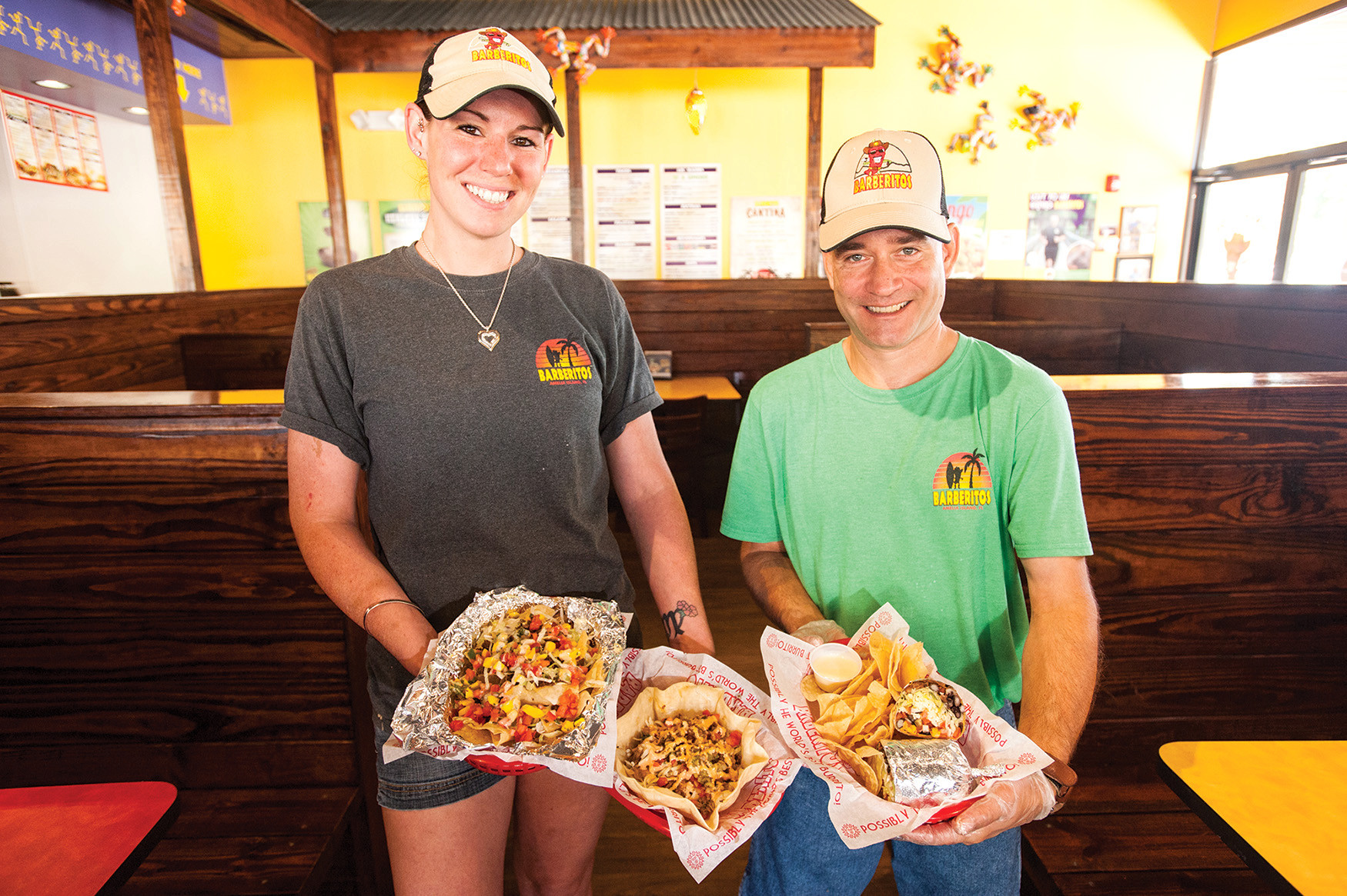 Dana McCaull and Jim Kistler of Barberitos in Fernandina Beach present a basket of nachos (left), a fajita salad and a veggie burrito.