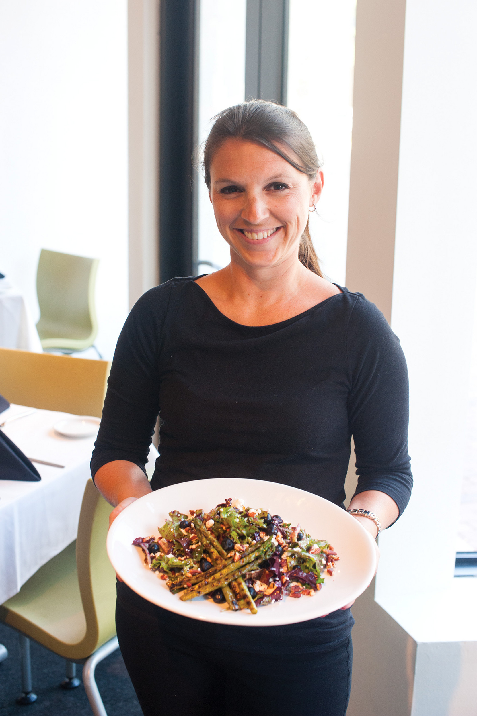 Jenna Cassel serves a grilled asparagus salad with blueberries, goat cheese and pecans at Café Nola inside Downtown's Museum of Contemporary Art Jacksonville.