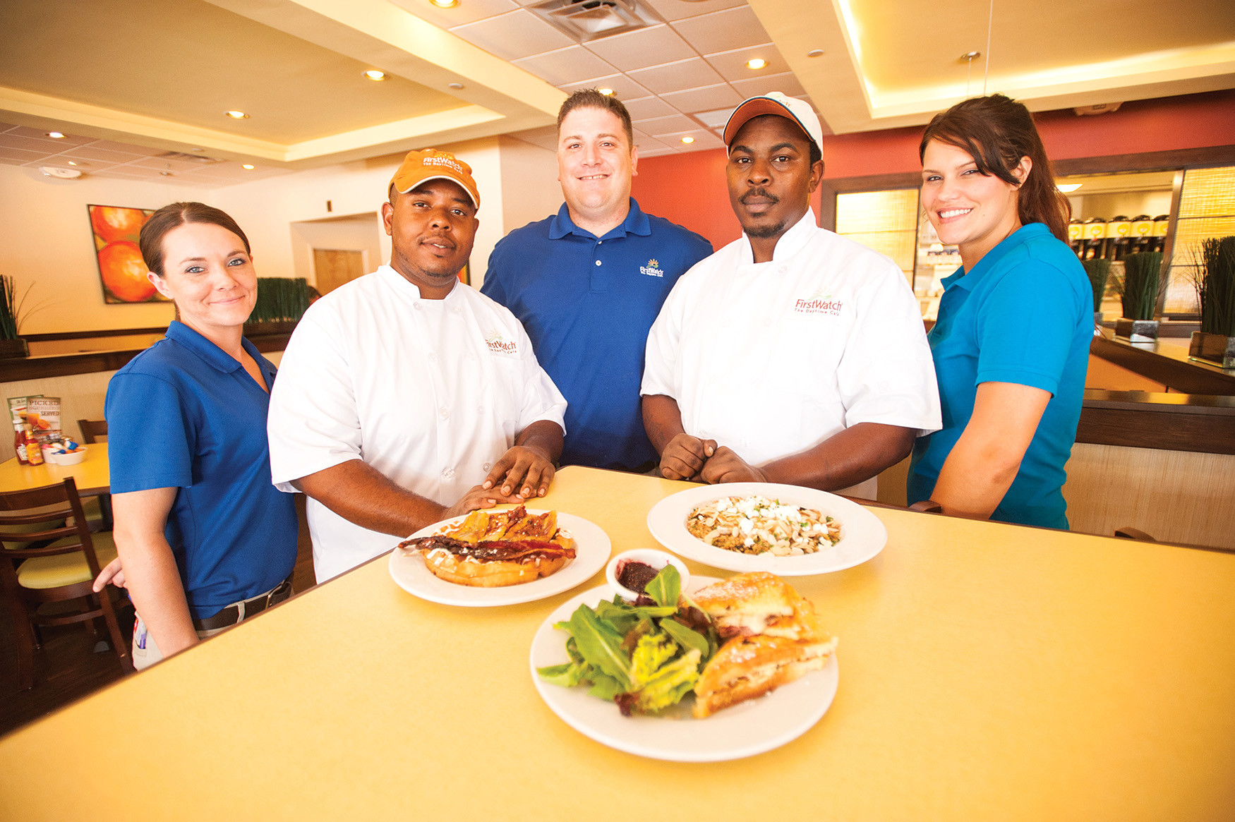 Chrystal Ransom, Chef Walter Hemphill, Manager Chris Davezac, Chef Glen Franklin and Kim Mixon of First Watch in Mandarin display the bruléed banana waffle, French toast Monte Cristo and summer cherry chicken quinoa bowl.