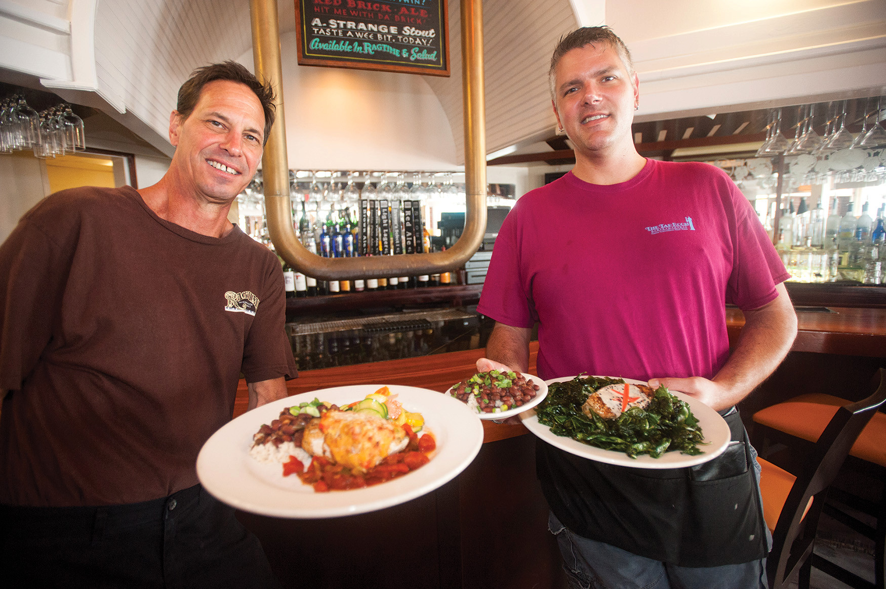 Ragtime Tavern Seafood & Grill in Atlantic Beach just celebrated its 30th anniversary. David Keys and Matthew Johnson invite you to try Andouille-crusted mahi topped with Cajun spices (left) and sesame tuna over fried spinach with ginger remoulade, red beans and rice.