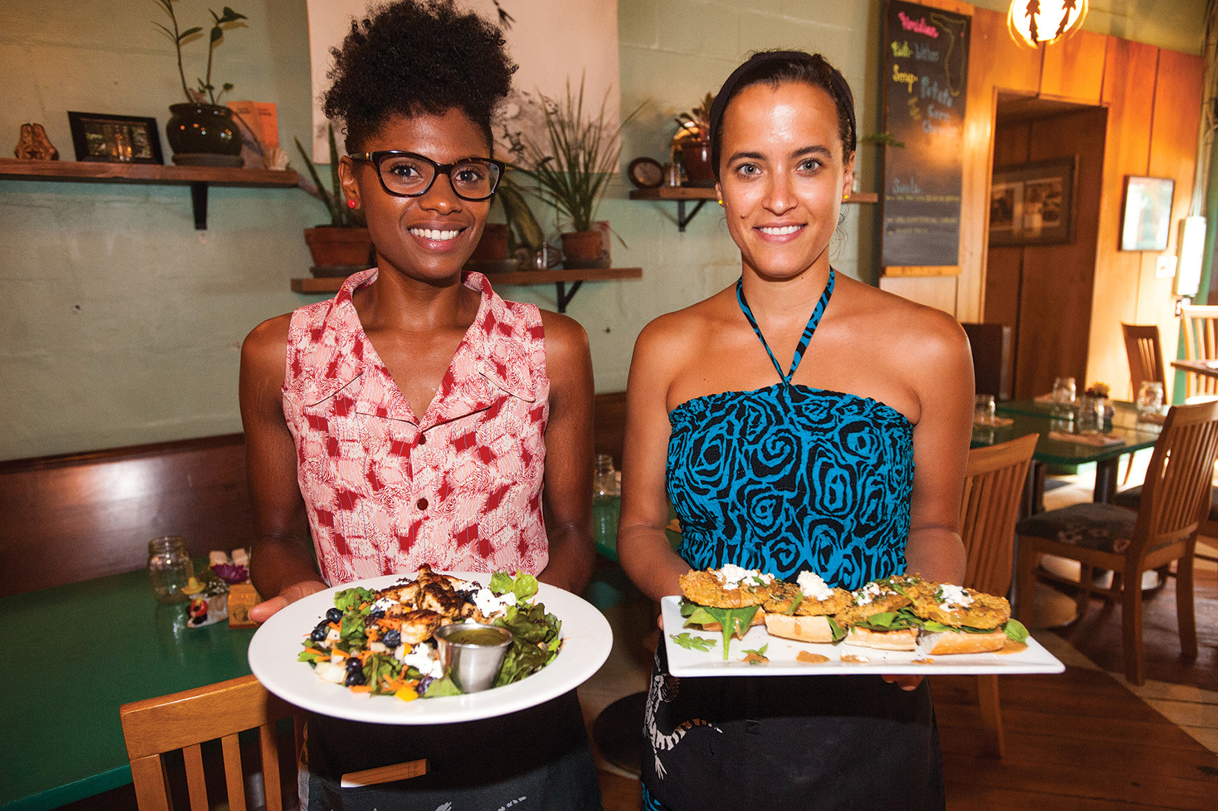 Nicole Jones and Lauren Woinski of The Floridian in St. Augustine present a summer salad made with blackened shrimp, blueberries, cucumbers, quinoa, local cheese and a honey herb vinaigrette (left) and a plate of cornmeal-dusted fried green tomato bruschetta with a cumin aioli sauce topped with feta.