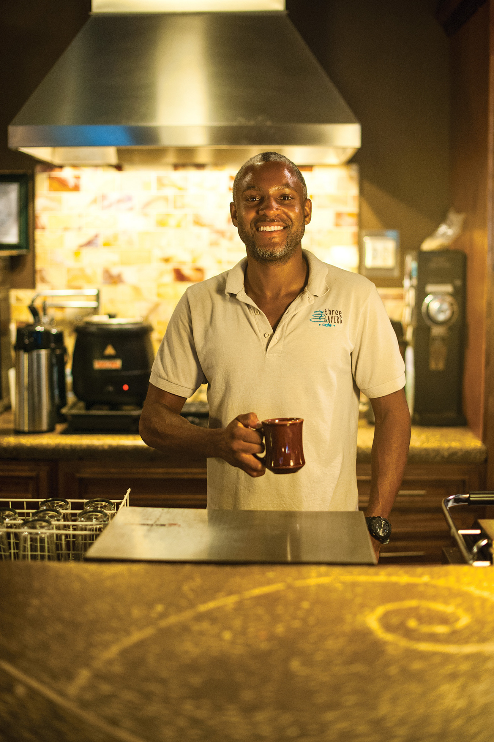 Barista Jermel Forehand of Three Layers Café in historic Springfield enjoys a cup of French roast coffee.