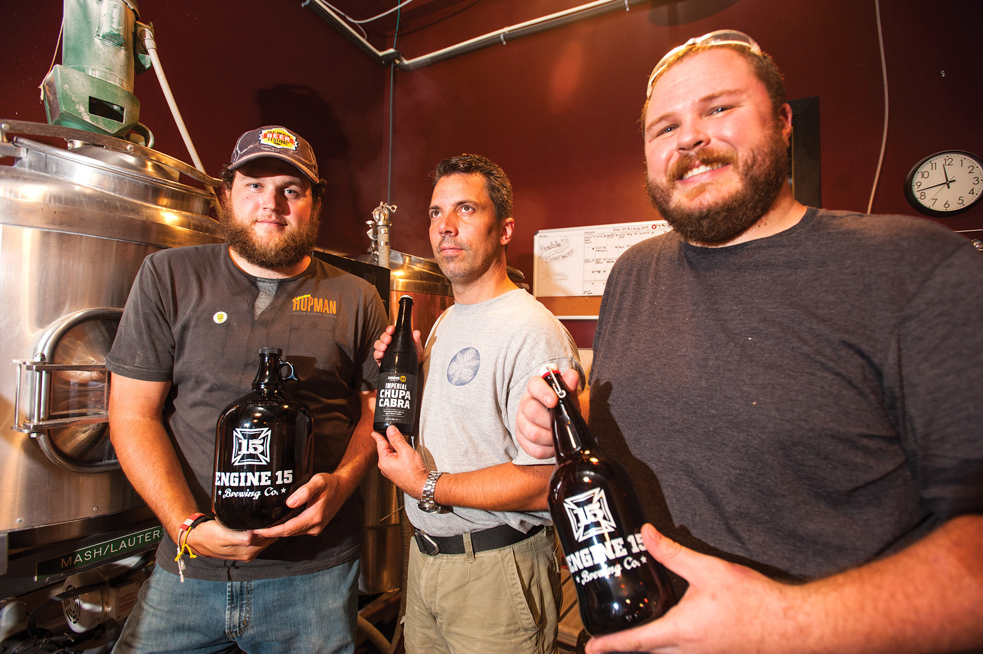 Sean Bielman (from left), Brewmaster Luciano (Luch) Scremin and David Morenus create the atmosphere of a brew pub in the Fatherland with a Jacksonville Beach bent at Engine 15 Brewing Company.