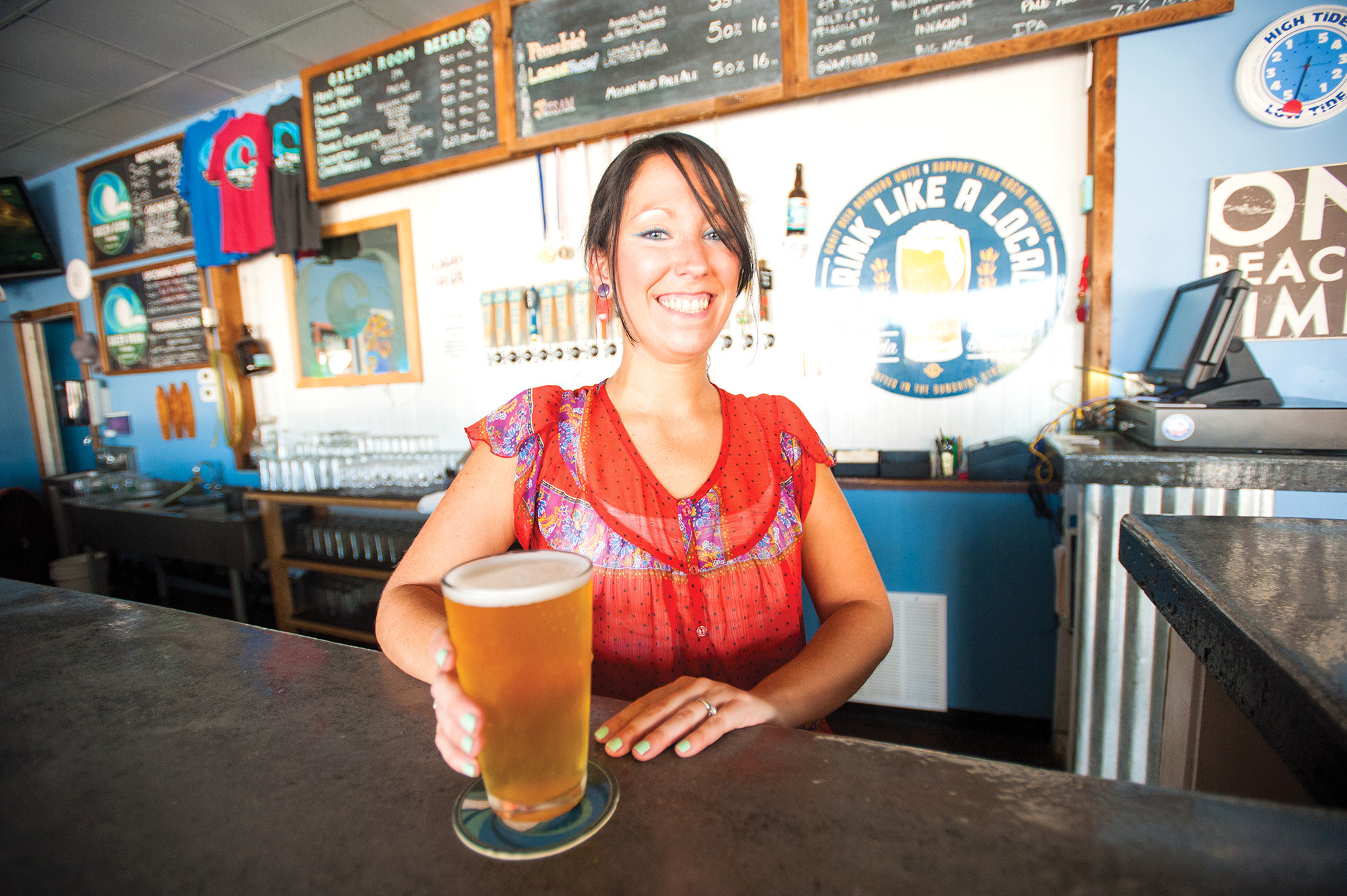 Bartender Christina White serves up a Lemon Fresh lemon ale with lactose and vanilla at Green Room Brewing.