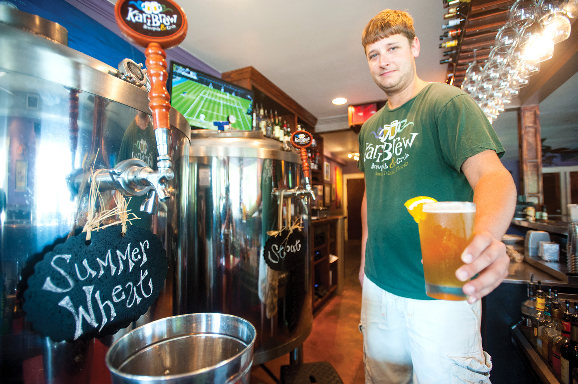 Nolan Winarchick pours a seasonal Summer Wheat at Karibrew Brew Pub & Grub, where Old Florida meets new for a pure urban funk atmosphere.