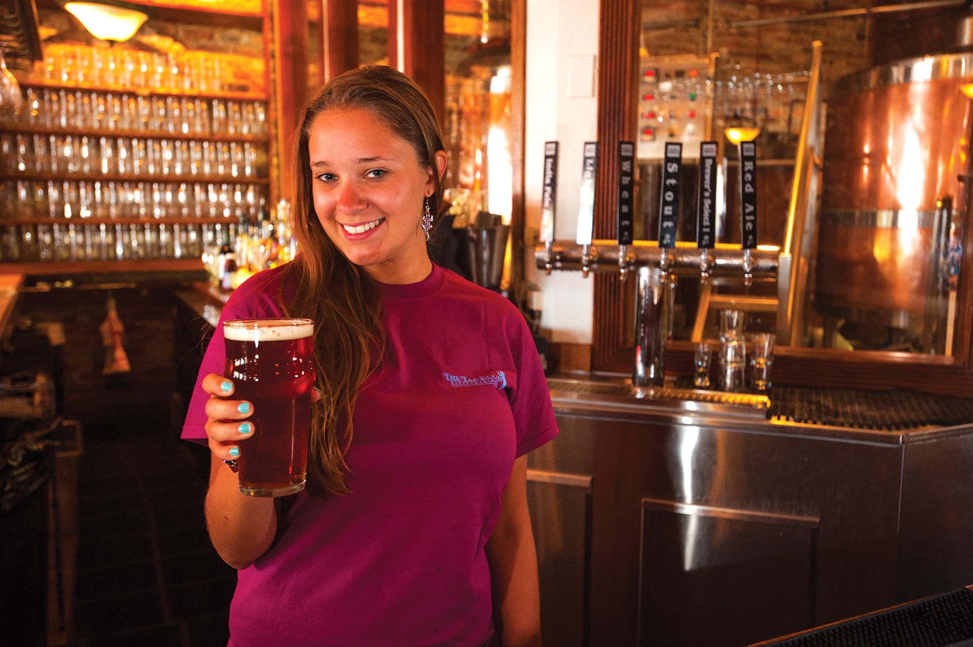 Ragtime Tavern & Seafood Grill has been brewing beer onsite since 1993 — like this Red Brick Ale served by Stephanie Wantage.