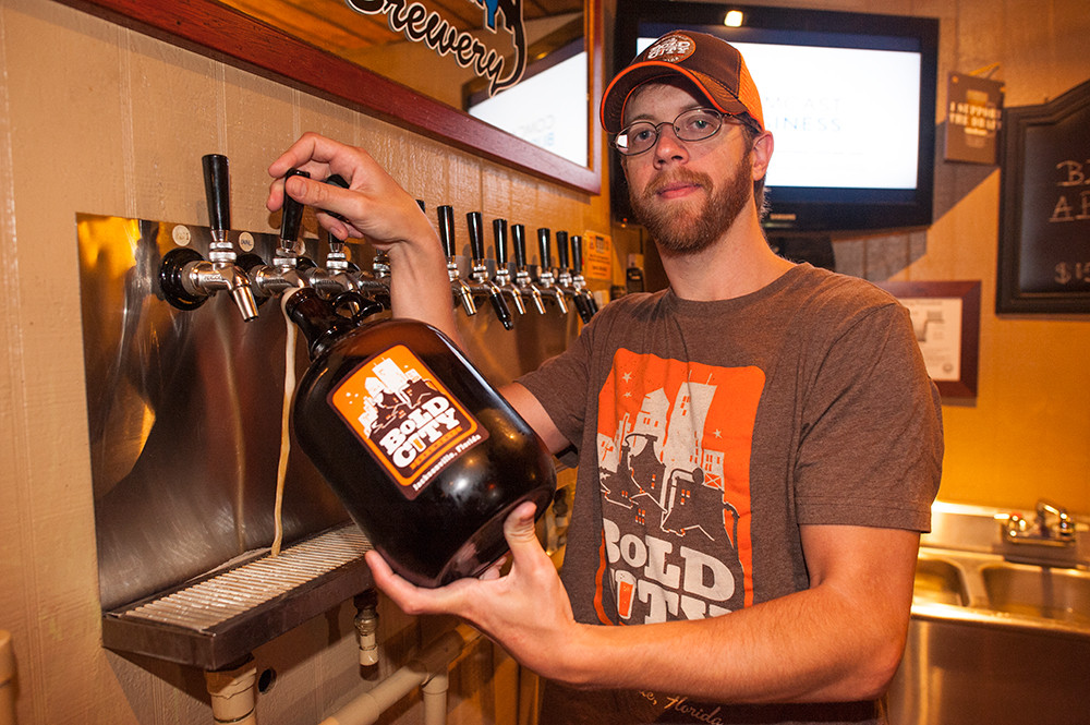 You can enjoy a pint in Bold City Brewery's laid-back taproom while Johnny Miller fills a growler with Duke's Cold Nose Brown Ale.
