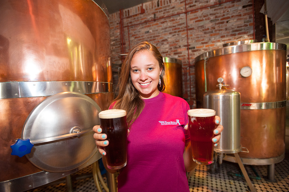 Stephanie Wantage serves up a Red Brick Ale and an India Pale Ale at Ragtime Tavern & Seafood Grill, which celebrates its 30th anniversary this year.
