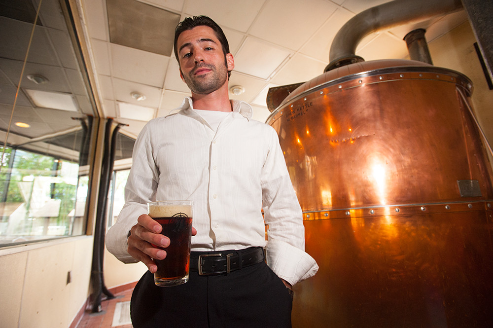 River City has been brewing since 1993, and Ryan Friedman shows off one of the brewing tanks.