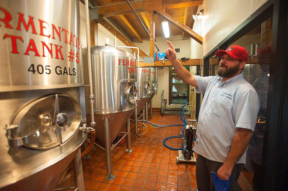 Brewmaster Aaron Nesbit brews five in-house specialties like Southside Pilsner Lager and Toll Tender IPA.