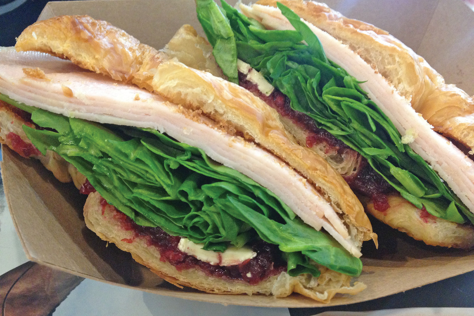 Turkey, brie, cranberry chutney and spinach on a flaky croissant is slightly reminiscent of Thanksgiving but light enough for a weekday lunch.