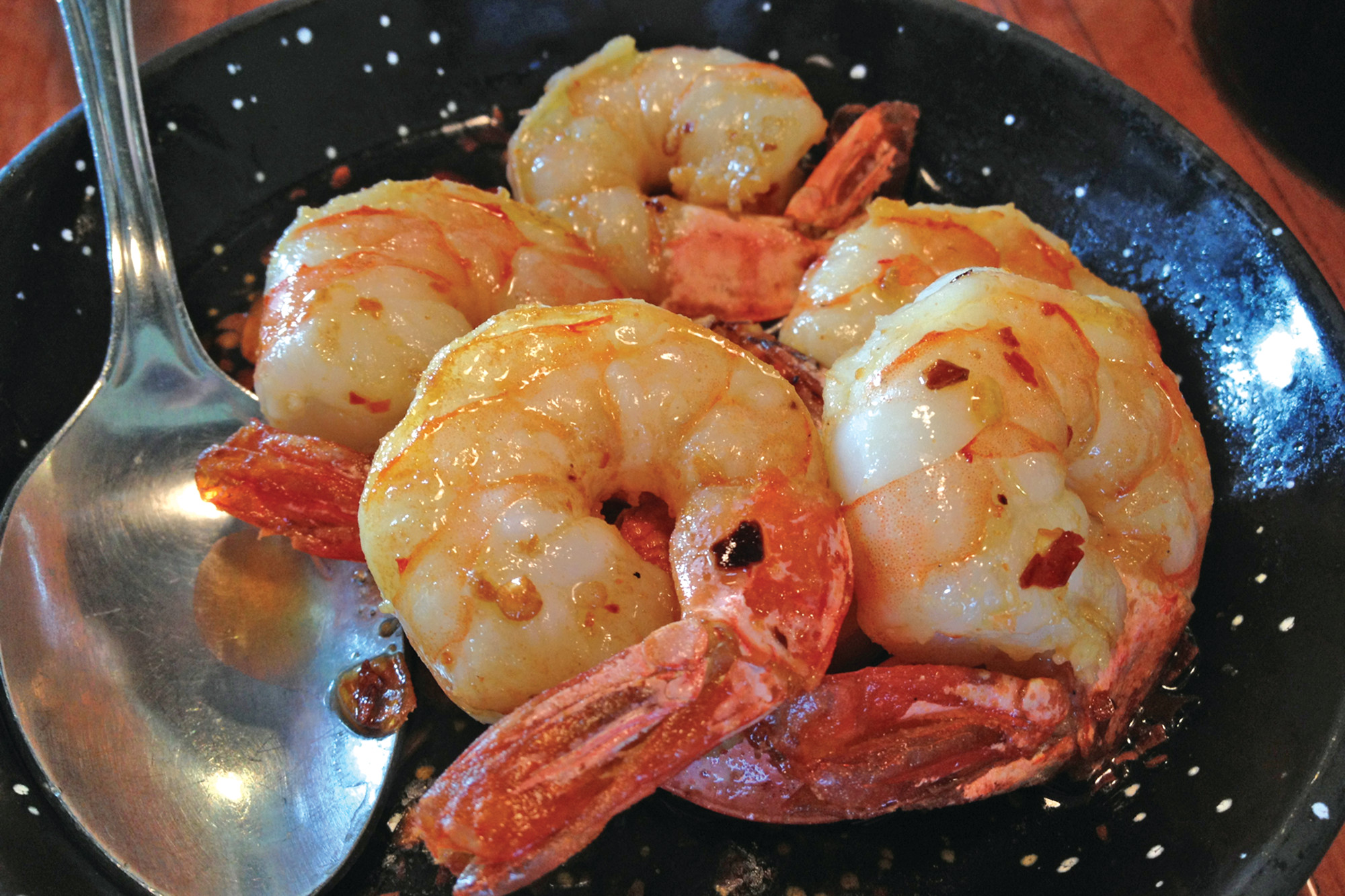 The shrimp sautéed in olive oil, garlic and crushed red pepper is a simple yet flavorful dish with a little kick.