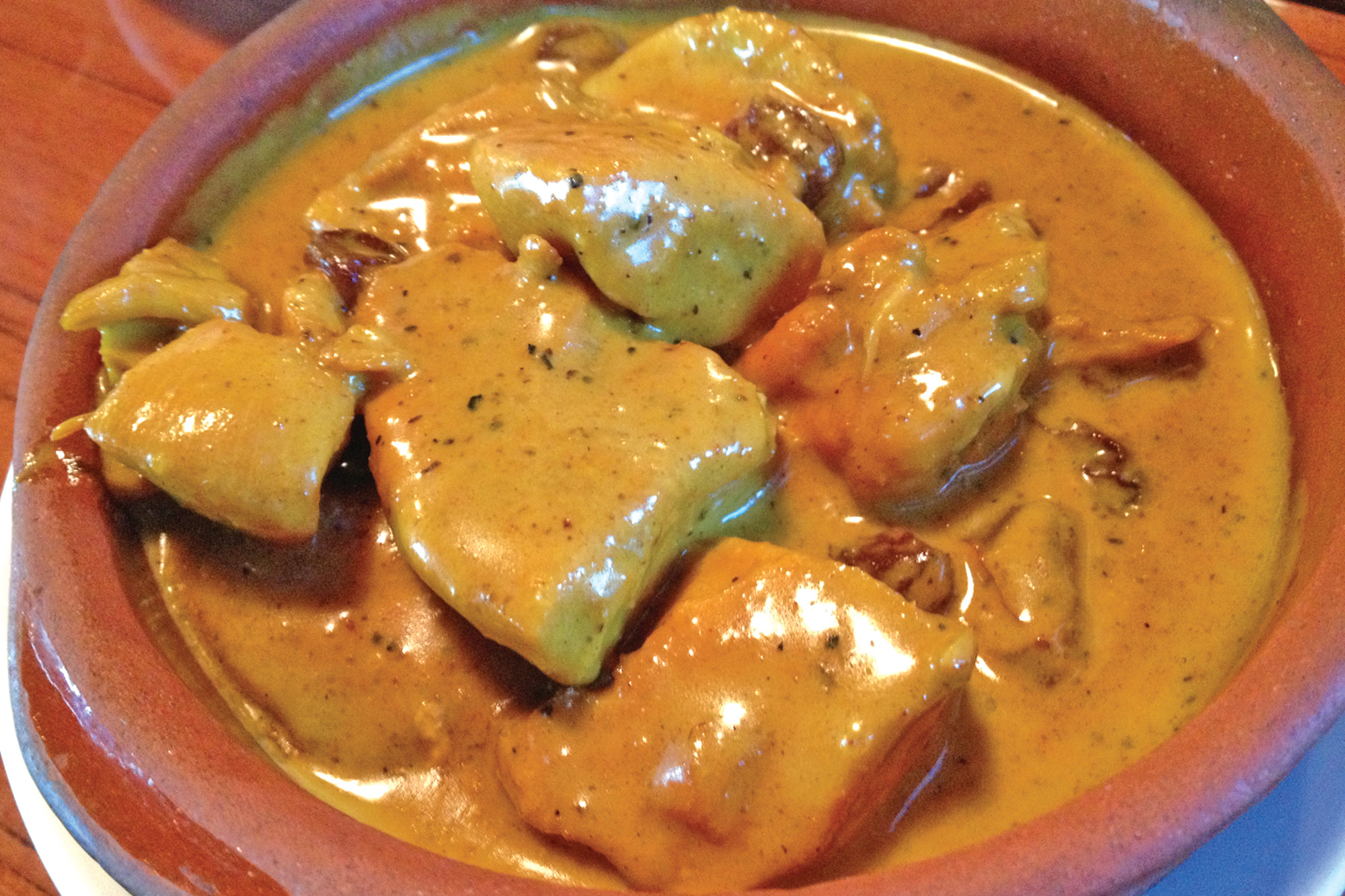 Chunks of tender white meat chicken breast are cooked in a creamy coconut curry sauce scattered with golden raisins.